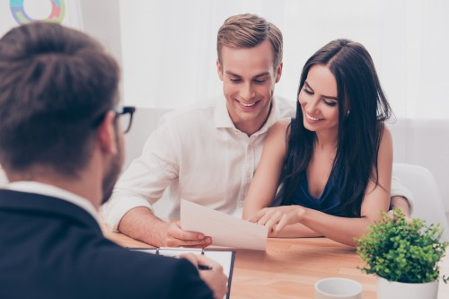 Financial advisor working with a young couple.
